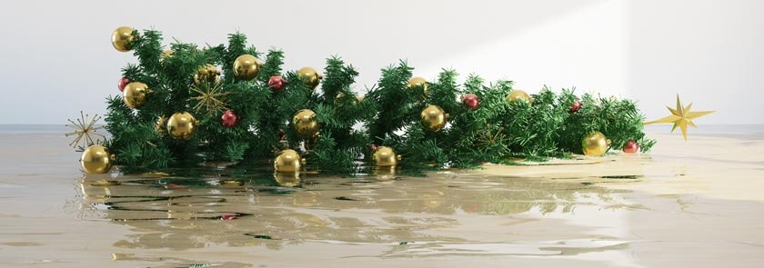 christmas tree laying down in flooded water in room